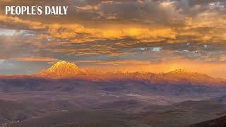 The snow mountain turned gleaming golden under the sunset in SW China's Sichuan province.