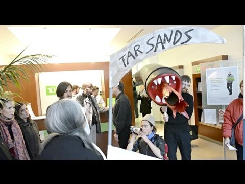 Creative Direct Action at Top Tar Sands financier by RT Seat