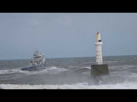 Oil Supply ship Makalu leaving Aberdeen Harbour during heavy swell & waves