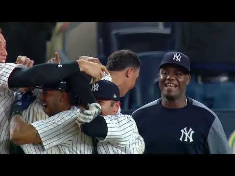 New York Yankees toss Ronald Torreyes in the air after game-winning play