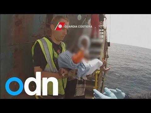 Baby rescued from immigrant ship by Italian coast guard