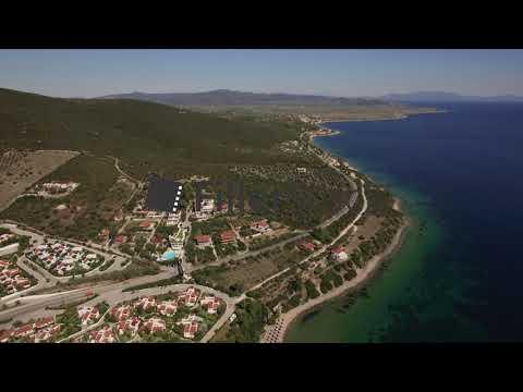 Aerial scene of sea, coastline and Trikorfo Beach with green hills. Greece