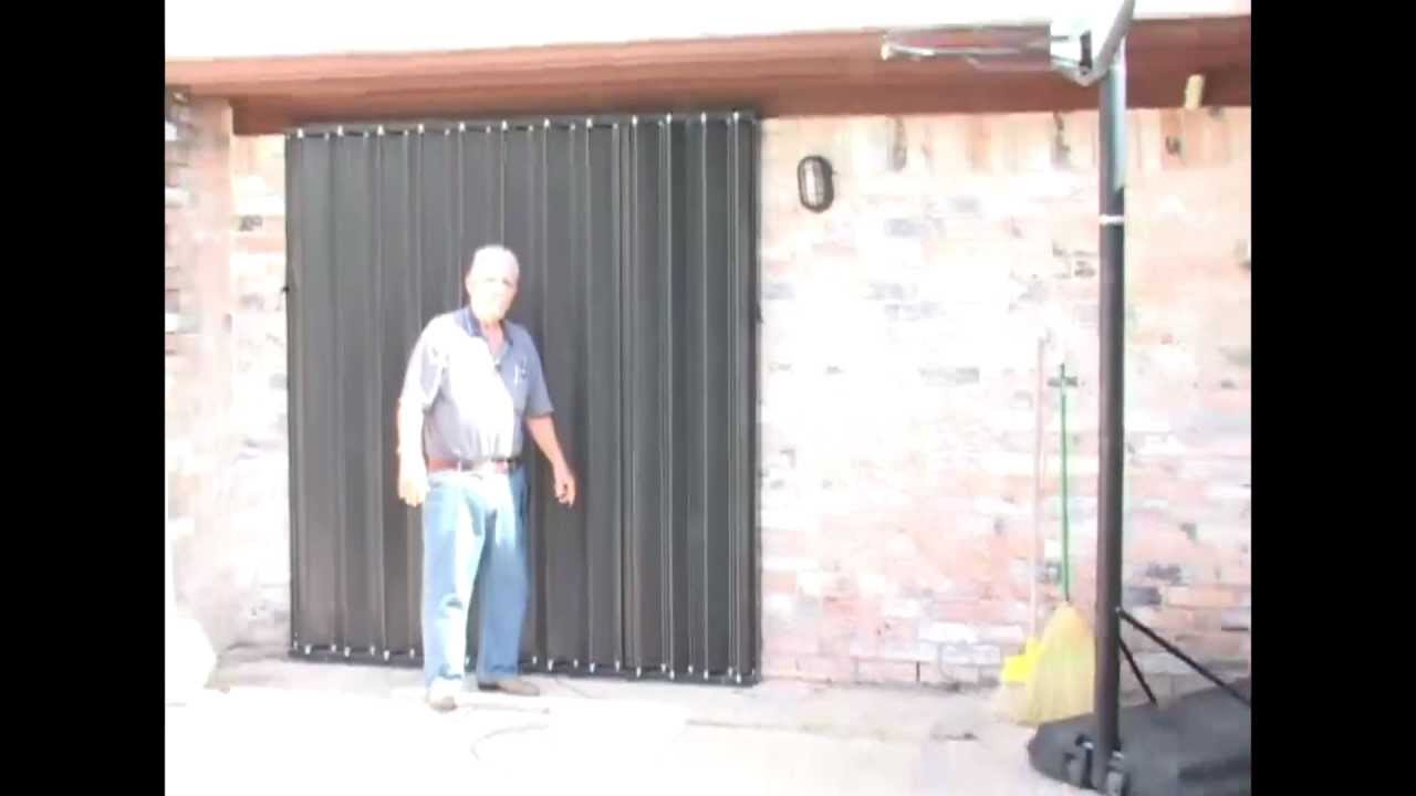 Accordion Hurricane Shutters Deployed By Homeowner.mp4