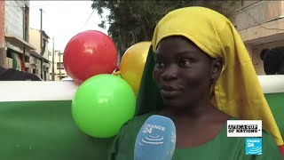 Senegalese football supporters prepare for the AFCON final