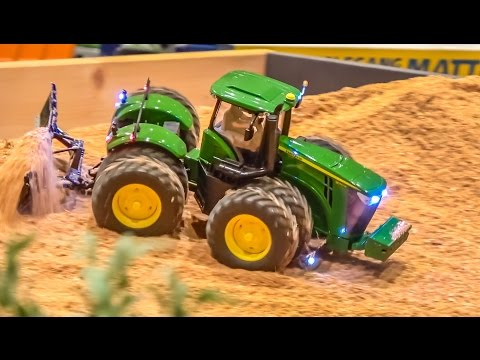 RC tractors, trucks and farming machines at work on a farm! John Deere & more!