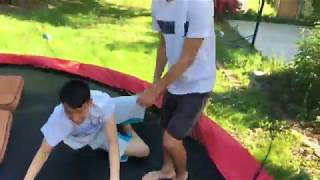 teaching buk lau how to do a backflip on trampoline