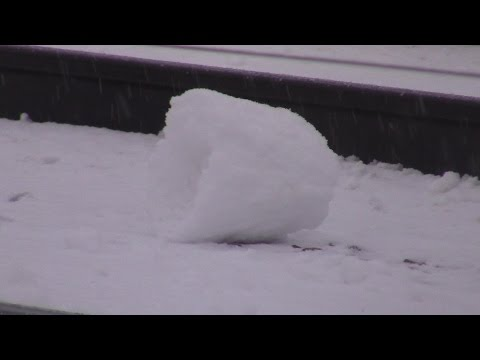 """Rare """"Snow Rollers"""" Blown by Fast-Moving Freight Trains"""
