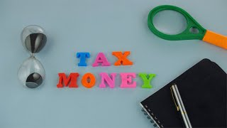 Tax Money - A notification or a reminder to file tax returns - business and finance concept