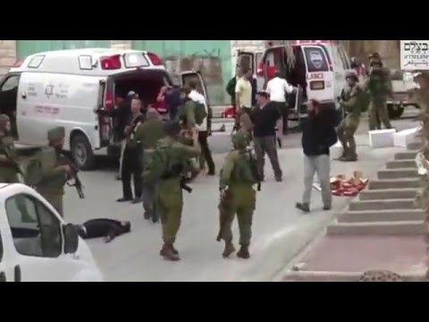 Soldier executing a wounded Palestinian lying on the ground after being stabbed soldier