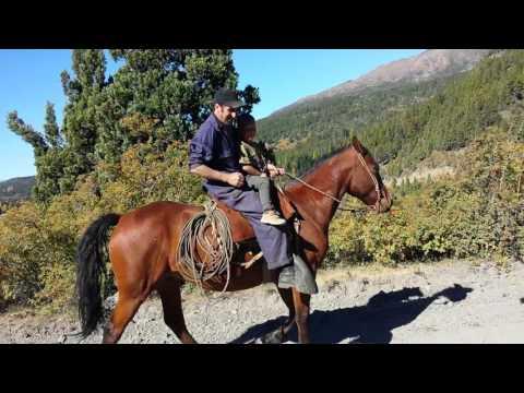 David riding horse with gauchos, Villa Rivadavia, Patagonia Argentina
