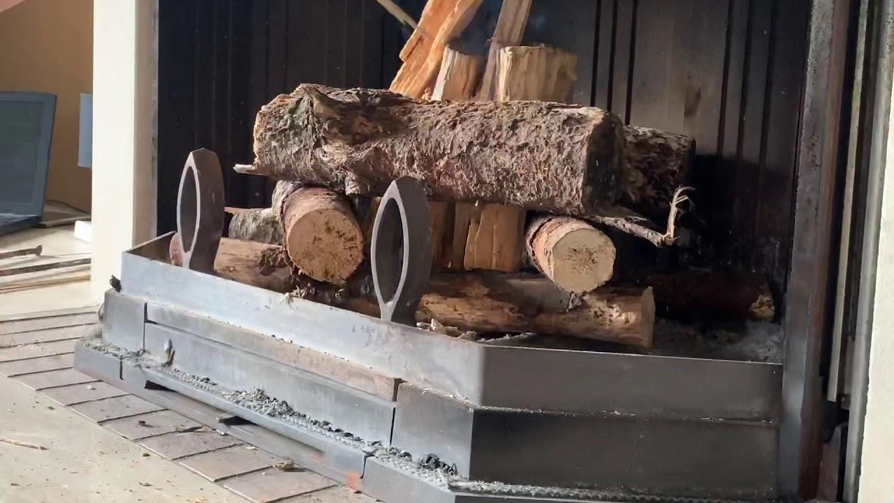 allumer un feu de cheminée sans allume feu - youtube
