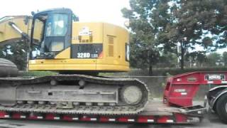 Peterbilt 379 HDG Hauling a Cat 328D LCR Excavator