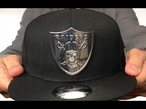 premium selection 447dd 9e41d Raiders  SILVER METAL-BADGE SNAPBACK  Black Hat by New Era