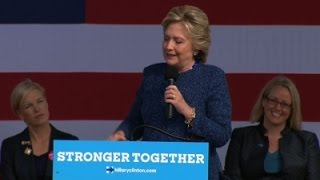 clinton ignores email probe hammers trump
