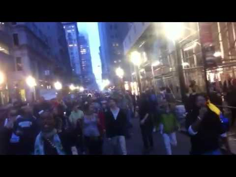 New York Observer: Occupy Wall Street marching down Broadway