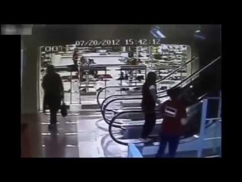 Old Woman Gets Stuck On Escalator Rail