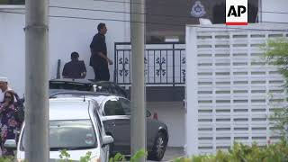 Police outside Malaysian ex-PM's house amid probe