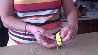 How To Make A Wire Hanger Book Holder