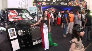 London Taxicab Next to Sexy Ema Shah in a Kuwaiti Flag Dress