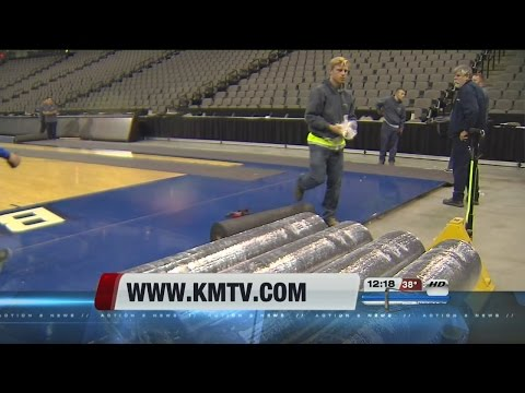 Crews install volleyball court for college championship in Omaha