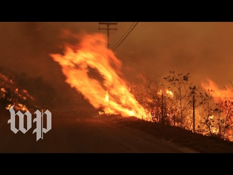 The neighborhood is on fire:  Wildfires ravage Southern California