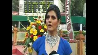 Zarine Khan slight cleavage show. Talks about Sachin