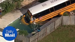 Florida school bus crashes into a pool avoiding a cat in the road