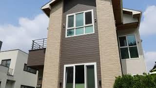 631 베이지와 브라운 세라믹 사이딩 마감, 지붕 밑면…