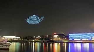 See Drones Draw Shapes in the Night Sky