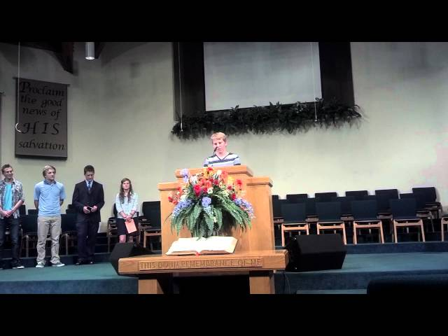 Nicholas speaking at church about S.T.E.P. mission trip