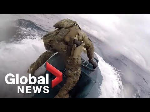 Mel Taylor - CRAZY! Badass Coast Guardsman Jumps On Moving Sub Full of Drugs