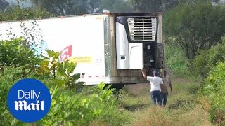 Truck holds 157 decomposing bodies behind Mexican housing complex