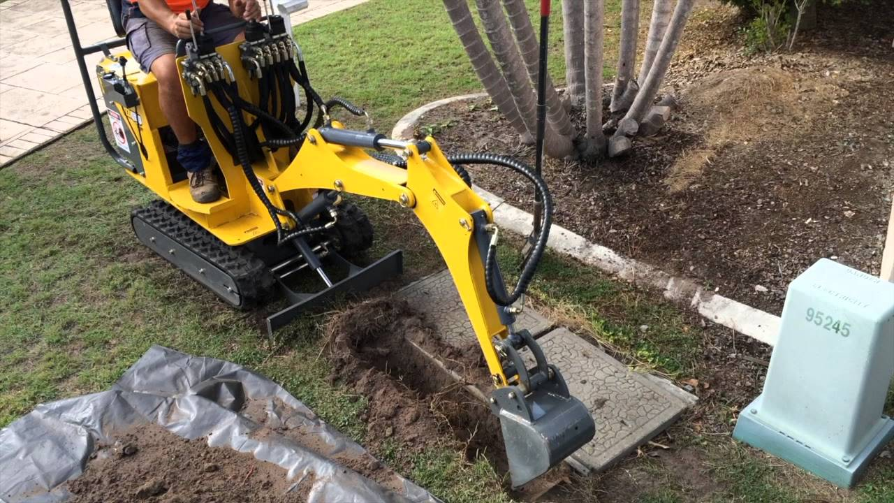 Ozziquip Mini Excavator Digging Out Telstra Pit