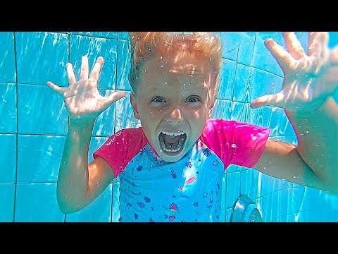 Kids Have Fun Playtime At Water Park With Giant Water Slide And Swimming Pool