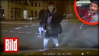 Fußgänger springt plötzlich aufs Taxi - Dashcam filmt Flug aufs Auto