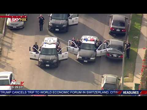 CROWD WATCHES ARREST: People living in South Central LA See End of Stop-and-Go Police Chase