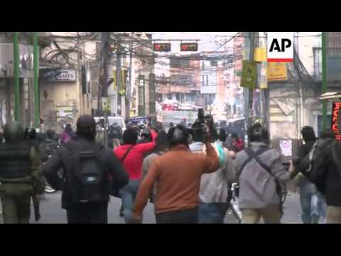 Strikers and police clash on the streets