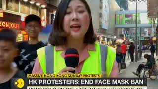 Hong Kong: Protesters reassemble for illegal march