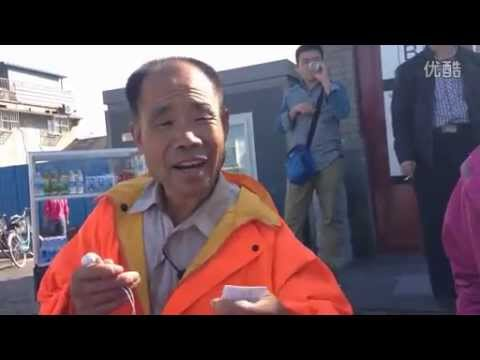 Elderly Chinese street cleaner speaks fluent English