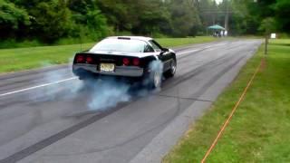 Black C4 Vette smokes em up leaving