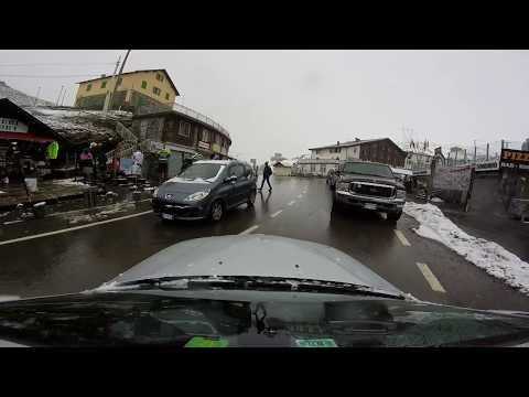 Stelvio Pass - Snow in July. - Hotel Perego parking lot...
