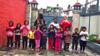 Kids from Nepal sings joyful song.
