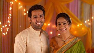Beautiful wife putting tilak of husband's forehead - Hindu Customs. Happy Indian couple celebrating festival