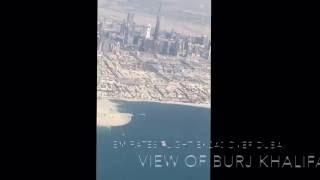 Emirates EK720 flying over Dubai City with view of Burj Khalifa