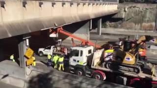 Bulldozer-Carrying Truck Hits Sydney Overpass