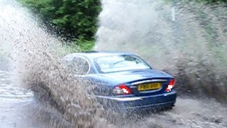 !Cars driving through Floods, lots of big splashes!