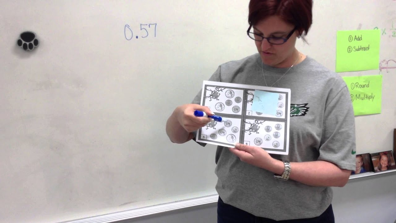 adding and subtracting decimals with money cards lesson