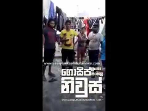 Fight between Sinhalese and Tamils who are dressed with LTTE sign shirts
