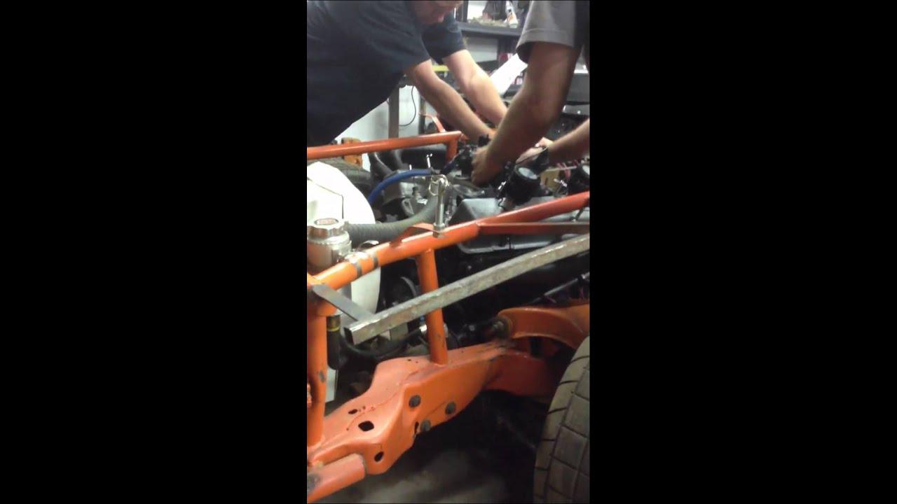 350 in a dirt track car mild cam open headers