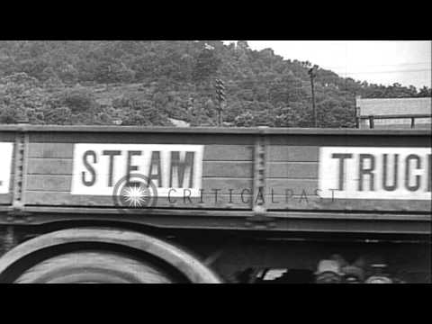 A coal-fueled, steam powered truck and a collision-proof car are demonstrated. HD Stock Footage